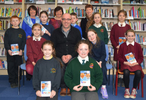 Library staff, Castleisland Family Resource Centre representatives and certificate recipients at the library at the completion of the book club run.  Front row:  Bríd Fitzgerald (left) and Ciara Casey. Middle row: Miriam O'Connell, Barthy Flynn, Castleisland Library; Jessica O'Loughlin, Ava McGovern. Back row: Jack Breen, Breda O'Connor, FRC; Meghan Dennehy, Marie O'Connor FRC; Jude McCarthy, Eileen Murphy, Castleisland Library; Muireann Walsh and Mya Griffin.