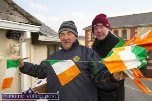 Early one morning: Charlie Farrelly and Ted Kenny out on 'Bunting Duty' in Castleisland on Sunday morning ahead of today's big parade in town at 1-30pm. ©Photograph: John Reidy 15-3-2015