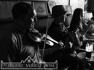 A session of traditional music in full swing at Sheila Prendiville's on a fine Saturday evening in July 06. Musicians included are: The late Dan Jeremiah O'Connor, Scartaglin; Jackie Dan Jerry O'Connor and his daughter, Mary from Castleisland. ©Photograph: John Reidy  15/07/2006