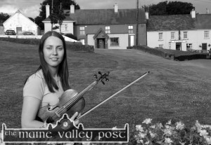 Emma O'Leary pictured in her native village - about which she will talk at the Scartaglin Heritage Centre in the second last in the Handed Down series on Saturday night at 8pm. ©Photograph: John Reidy 25-6-2003