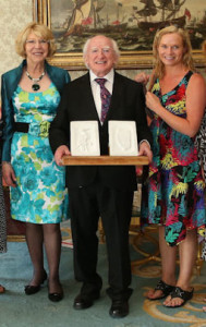President Michael D and Sabina Higgins receiving the set of carved, white marble bookends from Castleisland artist, Kate Shanahan at Áras an Úachtarán in July 2013.