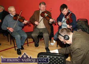 RTÉ Supporting The Arts: RTÉ Radio 1 / TG4 presenter / producer, Peter Browne recording a couple of tunes from this trio of: John Walsh (left) with father and son, Raymond and Eoin O'Sullivan at the launch of the Sliabh Luachra Music Trail at Ballydesmond Community Hall on Friday night. ©Photograph: John Reidy / The Maine Valley Post.  7-3-2014
