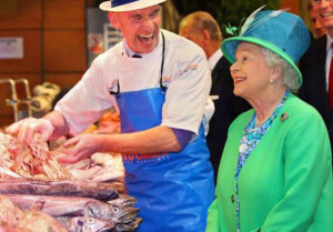 """During Queen Elizabeth's visit in May 2011 English Market fishmonger, Pat O'Connell cracked a joke about an ugly monkfish which he said was nicknamed """"the mother-in-law fish"""", prompting the queen to erupt in laughter. The moment was brilliantly captured by Killarney photographer, Valerie O'Sullivan."""