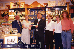 The Treasure Chest manager, Margaret O'Connor receiving a holiday voucher from Ray O'Brien of Waterford Crystal for sales of the Waterford Crystal products in August 1997. Included are : Seán O'Rourke, The Green Door Coffee Shop;  Paddy O'Hanlon, Waterford Crystal; Margaret O'Connor and Ray O'Brien, Helena Moran, Claire Fleming and Monica O'Connor, Slice of Life Health Shop. ©Photograph: John Reidy  1-8-1997