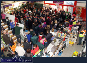 Past Masters at Crowd-Pulling: A section of the crowd gathered at Browne's Agri store for the announcement of winners in the annual draw last December. ©Photograph: John Reidy 19-12-2014