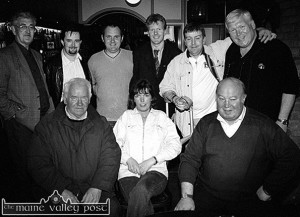 The RTE Radio One Five Seven Live team of the late Derek Davis and producer John McMahon stopped of at Skevenas Bar in Castleisland in May of 2002 to get the local feeling on the upcoming general election of that year. They are photographed here with the locals they fell into the company of. Front from left: Tim Downey, Kathleen O'Connor and John O'Sullivan. back from left: Michael O'Donoghue John McMahon, Martin Nolan, Ted Kenny, Denis Nolan and Derek Davis. ©Photograph: John Reidy 12-5-2002
