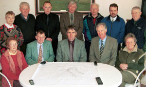 The late Dr. Arthur Spring (seated left) at the contract signing for Castleisland's new golf course at the club house of the shooting grounds in March 2000. Seated, from left, are: Committee member Betty McAuliffe, Andrew Kelliher, Castleisland and District Development Association; Mick Coote, Chairman  course development committee; the late Dr. Spring, course designer and Sheila Hannon, Chairperson C&DDA.  Back row: Millie Browne C&DDA; Richie Walsh, landowner and contractor; committee member, Tim Galwey, Michael O'Shea, Agronomist to the project; committee members, Larry Hickey, Michael Nash and Thomas Brennan. ©Photograph: John Reidy 29-3-2000