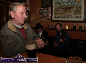 The late Denis Horan listening to a couple of tunes at Sheila Prendiville's Bar and Grocery during the annual Castleisland Horse Fair in 2009.  ©Photograph: John Reidy  2-11-2009