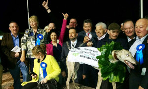 Maggie Prendiville and Tom Nolan with thumbs in the air for Midtown Raffa as trainer Mossie O'Connor receives the winning trophy. Included are: Jerry Buttimer, TD; Mary O'Connor, Moira Hughes, Mossie Leane, Tony Colbert and John Skevena O'Sullivan.