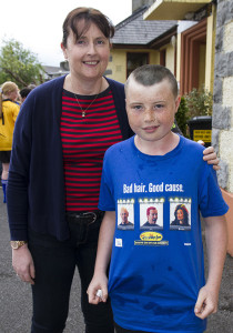 Proud mom: Melanie Walsh pictured with her son Conor after he and Luke Regan had their heads shaved in conjunction with the Today FM Shave or Dye fundraiser at Gaelscoil Aogáin in Castleisland on Friday. ©Photograph: John Reidy