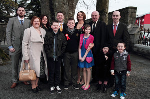 Back in February: Luke Regan pictured after he was confirmed by Bishop Ray Browne in Castleisland. Luke is with his parents Eddie and Helen, brother, Alex and sister, Ava, grandparents, Maureen and Sonny, uncles, Shane and Joe Walsh, aunt, Marilyn and cousins, Emily and Seán Walsh. ©Photograph: John Reidy 27-2-2015