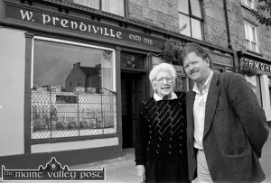 Proprietor, Sheila Prendiville pictured with Mike Kenny after his just finished sign-writing and presentation of the facade of the bar gained an honourable mention in the 1998 Tidy Towns report. A good night ensued. God be good to both of them. ©Photograph: John Reidy 18-9-1998