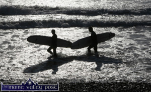 Surfers silhuetted against a sunlit, incoming tide on Kerry's  Bannna Beach .  ©Photograph: John Reidy