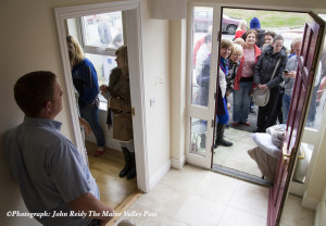 The door opens at No.8 Cahereen Heights this morning as the house hunting vigil holders wait their turn to place their deposits on the available eight houses. ©Photograph: John Reidy