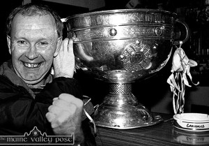 Cordal sports fan, Eddie Boyle pictured with the Sam Maguire Cup when it was brought on a visit to The Greyhound Bar in Castleisland after the 2000 All-Ireland campaign. Sam and its hurling counterpart, the Liam McCarthy Cup will meet in Cordal today. A meeting which rarely happens outside of Croke Park.  ©Photograph: John Reidy  11-11-2000