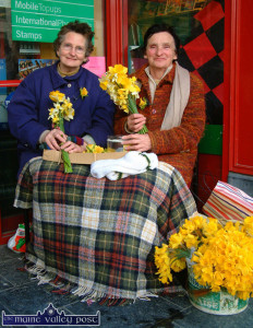 2004 Daffodil Day sellers, the late, Marie Downey (left) and the late Eily Curtin pictured at front door of Garvey's Super-Valu on Castleisland's Main Street. ©Photograph: John Reidy 19-3-2004