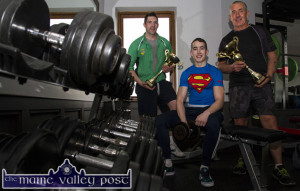 Double World Champion, Darren Moloney (centre) pictured with his father, John (right) and An Riocht AC gym instructor, Pa Murphy after his return from the World Drug Free Power-Lifting Championships in Telford, Bermingham at the weekend. ©Photograph: John Reidy