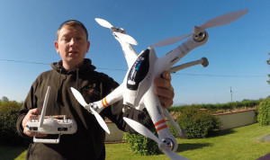 Eye in the Sky: Michael O'Rourke pictured with the 'Drone' with which he captured the early morning collection over Castleisland this morning.