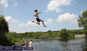 A flying leap:  A swimmer taking a flying leap into the River Feale at the back of the local town park.  ©Photograph: John Reidy