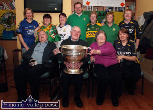 Castleisland Day Care Centre staff members and clients pictured during the visit of the Sam Maguire Cup on Wednesday. Included are: Michael Lenihan, Michael McAuliffe, Eileen Daly and Marie Cronin. Back from left: Helen Greensmyth, Noreen O'Sullivan, Mag Lenihan, Barry O'Mahony, Mary O'Sullivan, Eileen Cronin and Eileen Murphy.  ©Photograph: John Reidy 18-2-2015