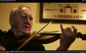 Paddy Jones doing what comes so naturally in Scart on World Fiddle Day 201.  ©Image from Christopher Garrett's film.