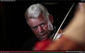 Singer and fiddle player, John O'Sullivan in action on home ground on World Fiddle Day 2015.  ©Image from Christopher Garrett's film.