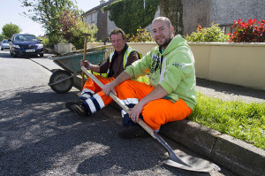 Timmy Murphy (left) and Daniel Jarza working on grass margin control in St. John's Park in May. ©Photograph: John Reidy
