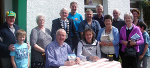 At the open-air book signing morning at Ballymacelligott Post Office were, front: Christopher Mannix, Con Dennehy, author;  John Lenihan, Margaret Groves, Nellie Brosnan and Ruairi Mannix. Back row : Tom McCarthy, Judy O'Connor, Cllr Pat McCarthy Mayor of Kerry; Gene O'Keeffe, John Brosnan, John O'Connor, Murthy McEllistrim and Catherine O'Connor. Photographs courtesy of Brendan Mannix.