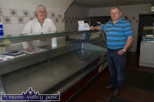 Retiring butcher, Jerome Stack with Kevin Walsh - one of his last customers at The Meat Centre at Upper Main Street, Castleisland on Sunday morning. ©Photograph: John Reidy