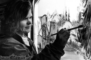 Emerging artist, Mary Owens painting a Christmas scene on the window of Ahern's old garage showroom at Limerick Road in December 1992.  ©Photograph: John Reidy 10-12-1992