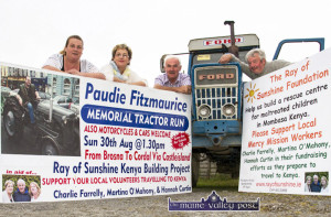 Castleisland volunteers, Hannah Curtin (left) pictured with Martina O'Mahony and Charlie Farrelly with tractor owner, John Horan helping them to flag the annual Paudie Fitzmaurice Memorial Tractor Run. The event, on Sunday, August 30th., will help to fund their mercy mission to Kenya with the Ray of Sunshine Foundation in February 2016.  ©Photograph: John Reidy