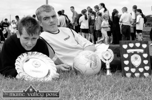 Garda Community Relations Inter Estates Soccer League winning captain and top scorer, James Coffey, St. John's Park (RIP) (right) and Player of the Final, Eamon Sheehy, Cahereens West pictured after the final at An Riocht AC Grounds.  ©Photograph: John Reidy 12-7-2003