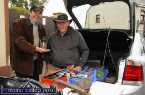 A bit of typical car-boot-sale dealing going on between Jim O'Sullivan (left) pictured with Denis Brosnan at his antiques stall at their local horse fair in Knocknagoshel last August. ©Photograph: John Reidy 16-8-2014