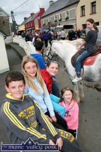Knocknagoshel Horse Fair made its first ever appearance on the village streets in 2012 and became a great hit. At the history making event were: Chris McCrohan, Amy Duncan and Tara O'Shea, Knocknagoshel and Catherine Somers, Lyreacrompane with Lucy O'Regan, Lyreacrompane on 'Billy' in the background. ©Photograph: John Reidy 16-8-2012