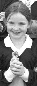 Cáit Lynch with an U-10 football medal in August 2000. She will be hoping to add a significant medal and trophy to her collection this year.