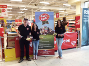 Mike McAuliffe with his daughters Natasha and Orla at Tesco in Tralee after the announcement of the deal between Truly Irish and the multi-national.