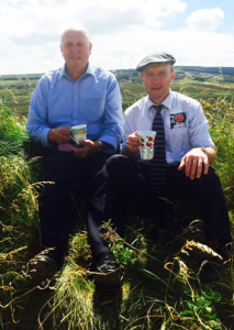 Everything Stops for Tea: Luke Keane and Michael Healy Rae pausing for a cup-out-of-the-hand during canvassing in Knocknagoshel yesterday.