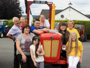 The Fitzmaurice family: Mary, Sharon, Pádraig, Laura and Ava with Ray of Sunshine Foundation volunteers: Charlie Farrelly holding little Tadhg Broderick, Hannah Curtin and Martina O'Mahony pictured at the end of the annual Paudie Fitzmaurice Tractor and Vintage Run at Cordal Community Centre.