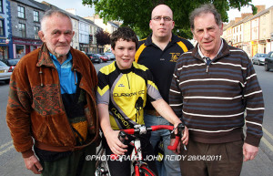 1958 Rás Tailteann winner, the late Mick Murphy (left) pictured with: Daragh Curtin, Knocknagoshel; Tom Kenny, PRO Currow Cycling Club and former Kerry Rás team member, Éamonn Breen at Thursday evening's launch of details of the An Post Rás stage finish in Castleisland on May 24. ©Photograph: John Reidy 28/04/2011