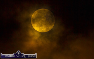 The Moon behind the moving cloud earlier this evening. ©Photograph: John Reidy