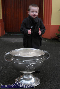 Yound Pádraig Curtin shows his appreciation for the visit of the Sam Maguire Cup to Gaelscoil Aogáin in Castleisland in February. ©Photograph: John Reidy