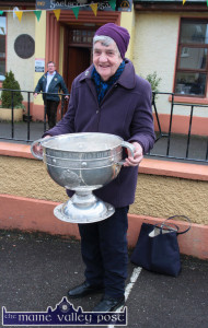 College Road resident, Kathleen Myers was on her way home with her morning's shopping when she bumped into the Sam Maguire Cup during the Castleisland tour in February. ©Photograph: John Reidy 18-2-2015