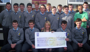 Sixth year students from St. Patrick's Secondary School, Castleisland presenting a cheque for €1063.47 to Sarah Flynn of Glebe Lodge, Castleisland. Front  from left: Brian Leonard, Kevin O'Connor, Sarah Flynn, Jack McAuliffe and Colin McCarthy. Middle row from left: Josh Kerin, Shane O'Donoghue, Conor O'Shea, Thomas McNally, Shane McGaley and John O'Sullivan, teacher. Back from left: Timothy Mitchell, Michael Cremins, Sean O'Donoghue, Kieran Griffin, Cian Mangan, Ryan Prendiville and Joe Crowley.