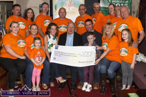 Jack &  Jill Children's Foundation CEO, Jonathan Irwin (seated centre) pictured receiving a cheque for €20,202.50 from the organisers and participants of The Longest Day Charity event. Included are, front: Norma Nolan-Moran, Eileen and Abbie Greaney, Fiona Clifford, Mr. Irwin, Ted and Conor Clifford, Georgina Fagan and Maria Greaney. Back row: Mike O'Sullivan, Maria Brosnan, Tom McCarthy, host; Denny Greaney, Gerry Fagan, Hugh O'Connor, Kevin Moran, Jerry Flynn and Jerry Courtney. ©Photograph: John Reidy