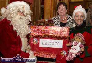 Castleisland Christmas Craft Fair organising committee member, Renee McCarthy, pictured with sepcial guests, Santa and his helper at the launch of details of the Castleisland Christmas Craft Fair at the River Island Hotel today.  ©Photograph: John Reidy