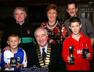 Rising soccer stars, Shane (left) and Eamon McLoughlin pictured with FAI President, David Blood and their parents, Mary and Eamon and coach, Georgie O'Callaghan (back left) at the Castleisland Soccer Club Awards Presentation night at the River Island Hotel on Friday night. ©Photograph: John Reidy 20/01/2006