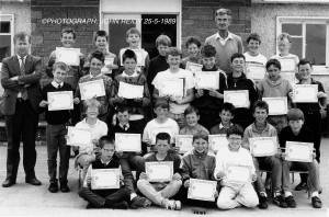 The same class on their final year at 'The Masters.'  Boys' National School / St. Pat's Secondary School Computer Cert recipients. Front from left: Derry Prendiville, Eoin O'Sullivan, Bertie O'Leary and ??? ??? . Second row from left: Billy Bourke, Kevin Ryan, Michael Buckley, Paul Geaney, Shay Prendiville, Mark O'Mahony and Patrick Breen. Third row from left: Eoin McGillicuddy, William Walsh, Kenneth Dillon, Tom Nolan, Edgar Prendiville, Tony Barry, John Broderick and Seamus O'Connor. Back from left: Kevin Quirke, computer teacher, St. Patrick's College; Donal Buckley, Kieth McCarthy, Gerard Myers, Mossie Lyons, John Horan, John Pender and Diarmuid Brandon. Can someone name the boy at the right of the front row now known only as: ??? ??? ©Photograph: John Reidy 25-5-1989