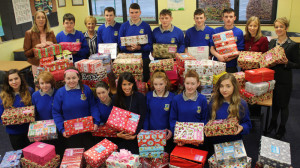 Ready to go: Teachers and pupils at Castleisland Community College pictured with the collection which resulted from their annual Christmas Shoe-Box Appeal.