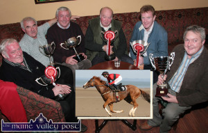 Members of The Island Syndicate pictured at their AGM at The Kingdon House on Thursday night with some of the haul of cups won by their wonder horse Patch in the course of the 2007 season. From left: Martin Morrissey, RIP; Charlie Farrelly, Bob O'Sullivan, RIP; John Skevena O'Sullivan, Ted Kenny and John Ryan. Inset: Patch with Danny Mullins in the saddle in action at Asdee Races that year. ©Photograph: John Reidy 06/12/2007