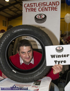 Suitably A-Tyred: Niall Murphy from Castleisland Tyre Centre showing his seasonal wares at last month's Bank of Ireland Castleisland Enterprise Town Expo. Photograph: John Reidy 13-11-2015